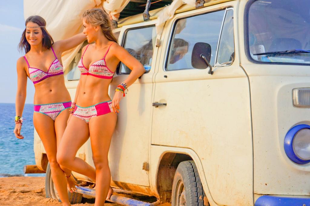 Bikini models hanging out at the kombi